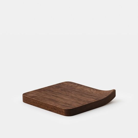 These elegant coasters are hand-made by Mitsugu Morita of Mogu-Kagu Studios  in Fukuoka, Japan. The slightly curved corner provides a graceful and  whimsical characteristic, as well as making the coaster easier to grab and  pick up. Crafted out of solid cherry and walnut, with an oil-based satin  finish that enhances the natural color and beauty of the wood.  Designer: Mitsugu Morita Maker: Mogu-Kagu Material: Walnut (dark), Cherry (light) Dimensions: 9.5 × 9.5 × 1 cm Origin: Japan