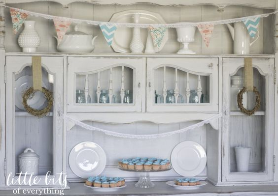 This vintage hutch is the perfect backdrop for this precious aqua and coral baby shower! #babyshower