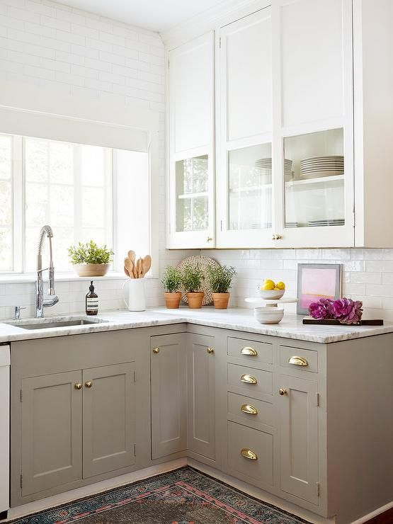 Upper cabinets with solid upper portion. Displays pretty things, hides not-so-pretty.