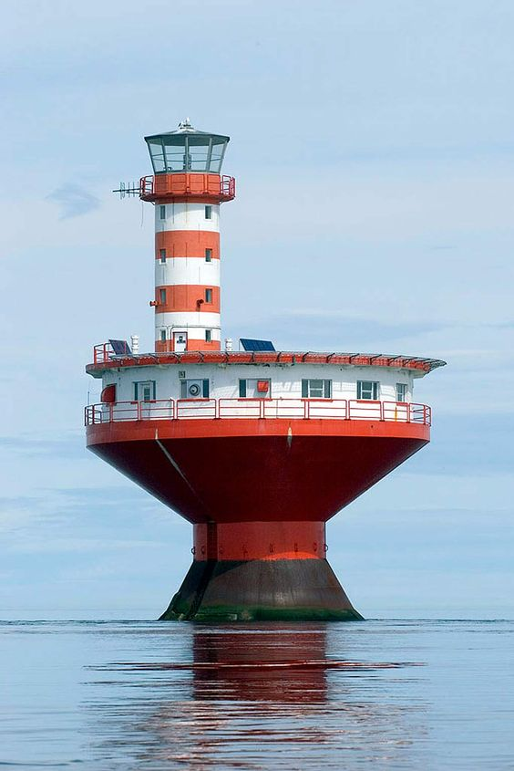 (Haut-fond Prince Light)  One of the most dangerous shoals in the St. Lawrence River is found near Tadoussac, Quebec, off mouth of Saguenay River.  The cylindrical tower with red and white horizontal stripes, on top of circular dwelling on caisson, resembles a child's top. Built in 1964, the light replaces the Prince Shoal Lightship station, that had been established in 1902. The lighthouse warns passing vessels of the undersea hazard in the area. The tapered base helps it resist the 20-foot…