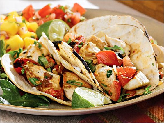 "Chicken tacos with charred tomatoes.   Charring tomatoes in a hot, dry skillet makes them smoky and flavorful; in combination with fresh herbs and spices, they elevate this dish from ""everyday"" to ""ta-da!"""