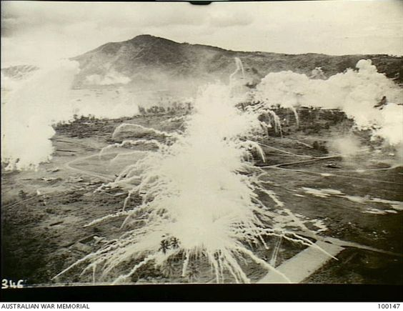 Simpson Harbour, Rabaul, New Britain. 1943-11-02. Aerial photograph of bombing raids on Japanese shipping in the harbour by RAAF B25 Mitchell bomber aircraft supported by P38 Lightning aircraft of ...