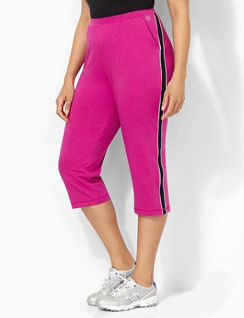 An essential piece for your on-the-go looks, our comfortable capri stands out with its contrast color piped stripes that cascade down the sides of the pant legs. All-around elastic waistband. Hip pockets with heat seal flourish on left pocket. Catherines pants are specifically designed with the plus size woman in mind.  catherines.com