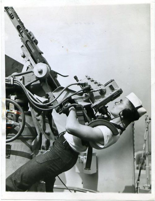 US sailor manning an anti-aircraft gun, 1943.