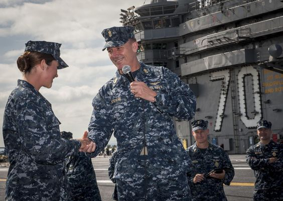 Master Chief Petty Officer of the Navy (MCPON)(AW/NAC) Michael D. Stevens shares.... SAN DIEGO (July 17, 2014) Master Chief Petty Officer of the Navy (MCPON) Mike Stevens gives his personal coin to Hull Technician Fireman Natalie Fitzpatrick during a question and answer session on the flight deck of the aircraft carrier USS Carl Vinson (CVN 70). Carl Vinson is pierside at Naval Air Station North Island. (U.S. Navy photo by Mass Communication Specialist 2nd Class George M. Bell/Released)