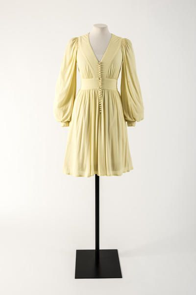 c.1974 Lemon yellow rayon jersey dress with row of domed buttons. Jean Muir: Bath Museum of Fashion