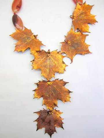 """Our items are custom made, please allow 2 weeks for delivery.Metal Large Leaf Leaf measurement: 2 1/2"""" x 3"""" with Carnelian stone.Measures around 16"""" to center, 16"""" total length"""
