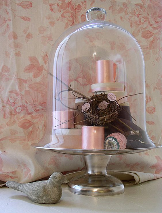 pink spools in a cloche