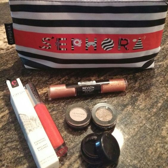 Brand new sephora includes Nars lip color Never used 2 Sephora eyeshadows, New Sephora makeup bag, Nars lip in cruela, 1 revlon eye art, cargo lip gloss and black mineral powder that can be used wet as an eyeliner and/or Smokey shadow eye look. Makeup