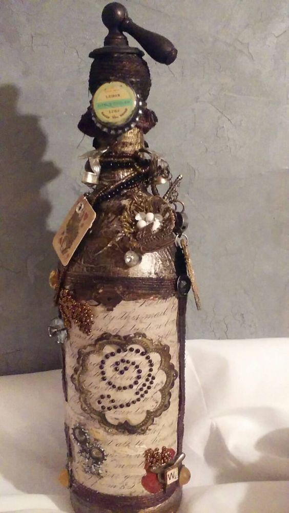 Check out this item in my Etsy shop https://www.etsy.com/listing/259377967/steampunk-bottle-with-old-script