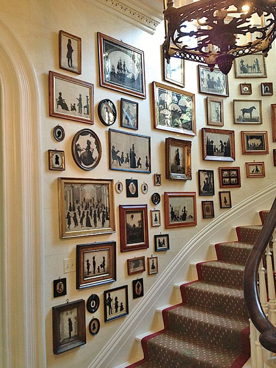 A collection of silhouettes provides the decor in the stair hall of Charleston's Mikell House, home to Southern Charm's Patricia Altschul.