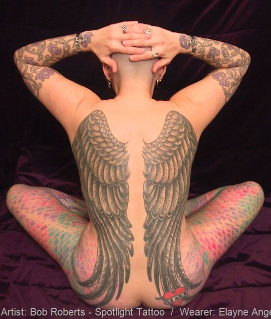 Tattoos by artist Bob Roberts. I can't decide whether I like the angel wings better than the fish scales :)