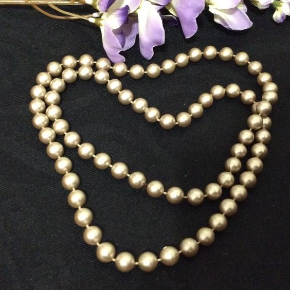 "Pearls in Beige These beautiful beige pearls make a statement. Not sure what other color to call them but they're grayish, more like pewter and rich looking. The flash makes these pearls look pale. 30""L. Very stunning Jewelry Necklaces"