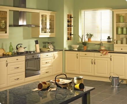 Ivory cabinets gray floors and countertop with green for Grey kitchen cabinets with red walls