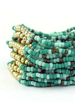 Turquoise and gold bead bracelet.