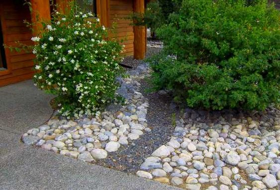 front yard river rock landscaping ideas are easy ways to eliminate maintenance  adding a small