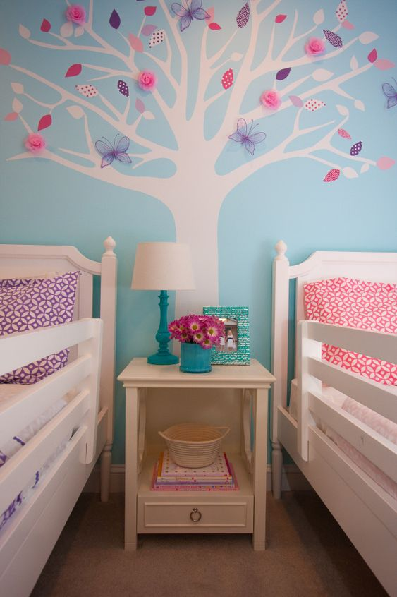 This shared big girl room features a tree wall decal with leaves that can change with the season! #socool #biggirlroom