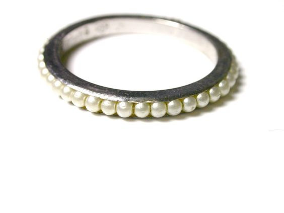 Band, next to single pearl ring? beautiful!
