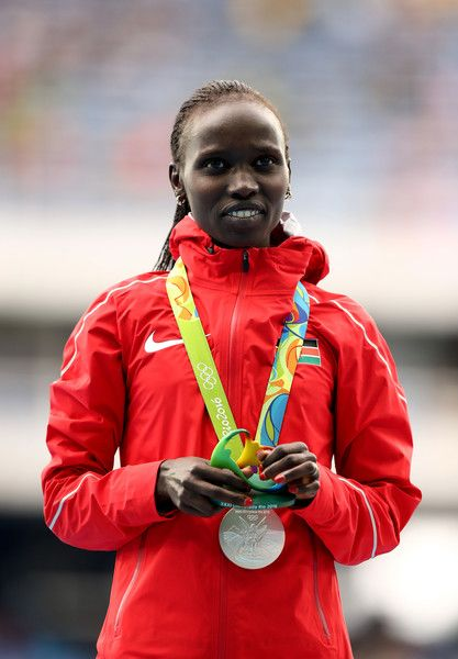 Vivian Jepkemoi Cheruiyot of Kenya poses with the silver medal for the Women's 10,000 Meters Final on Day 7 of the Rio 2016 Olympic Games at the Olympic Stadium on August 12, 2016 in Rio de Janeiro, Brazil.