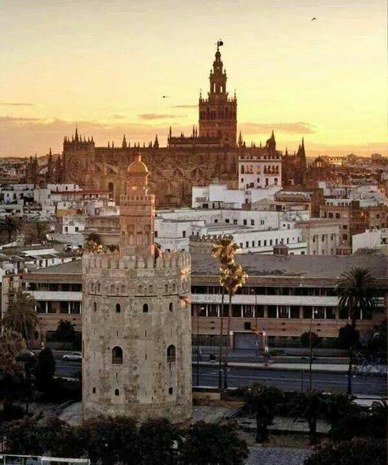 Torre del Oro (Tower of Gold,  13th century), Cathedral (1401-1507) and Giralda (bell tower of the Seville Cathedral) in Sevilla, Spain.