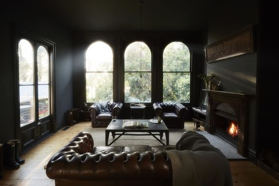 Interior design and styling by Kali Cavanagh // black walls, leather chesterfield sofa