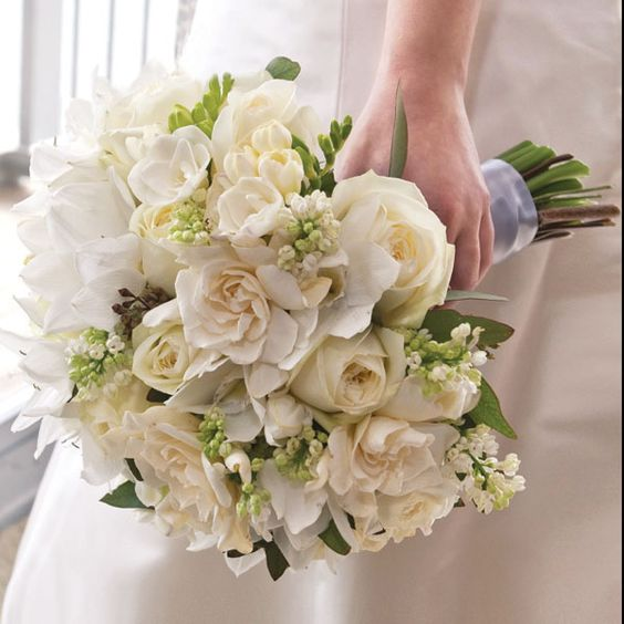 Beautiful bridal bouquet with freesia, roses and gardenia