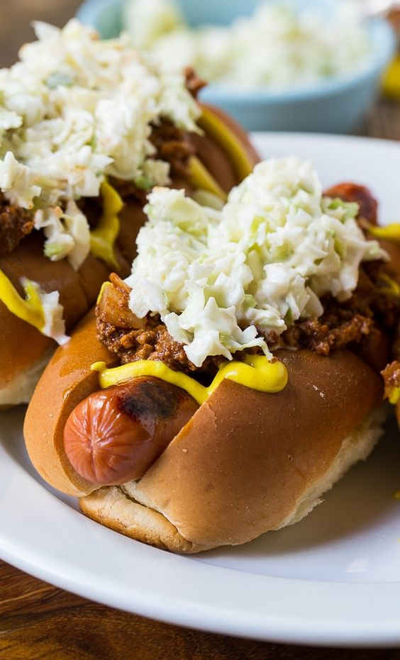 Carolina-Style Slaw Dogs with mustard and homemade chili.