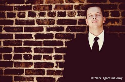 The groom, Matt, went for a modern looking tuxedo. I like the photo against the brick wall.