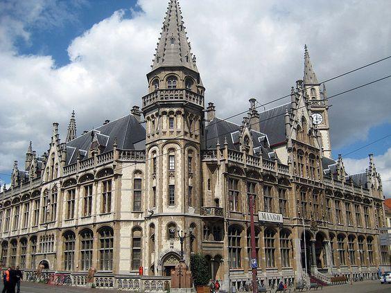 Het voormalige Postgebouw aan de Korenmarkt in Gent, naar het ontwerp van Louis Cloquet, werd tussen 1898 en 1909 gebouwd op de plaats van een aantal fraaie oude huizen. Het is opgetrokken in eclectische stijl met overwegend neogotische en neorenaissance-invloeden. De gevel is overvloedig versierd met beelden en wapenschilden.