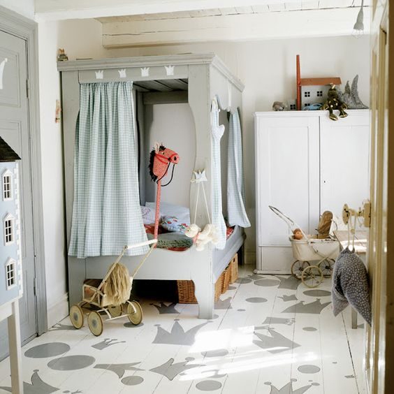 Whimsical boys room.  Painted floors, antiques, and custom bed with privacy curtains.