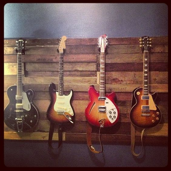 Pallet wood guitar wall                                                                                                                                                      More