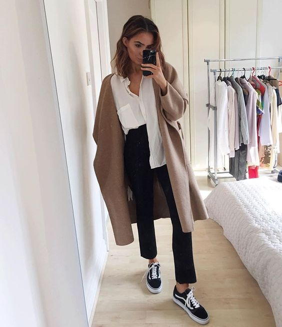 camel coat, white blouse, black jeans, old school vans, short beachy hair: