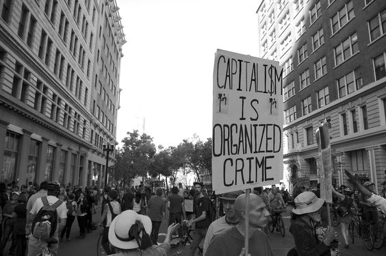 """""""Capitalism is an Organized Crime"""" - Occupy Oakland, Oakland, CA."""