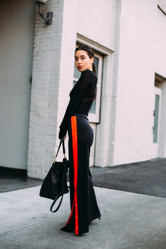 STYLECASTER | Superbowl Outfits | Street style influencer wearing athletic pants