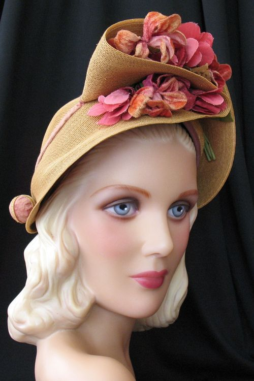 A draped hat from the 1940s, with a corseted back    I could make this with a plain and floppy straw hat I'm very tired of...: