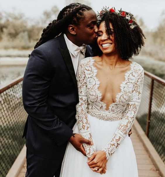 Stunning! Look at the love! Natural hair bride, dreadlock wedding, flower crown, lace wedding dress, black love.