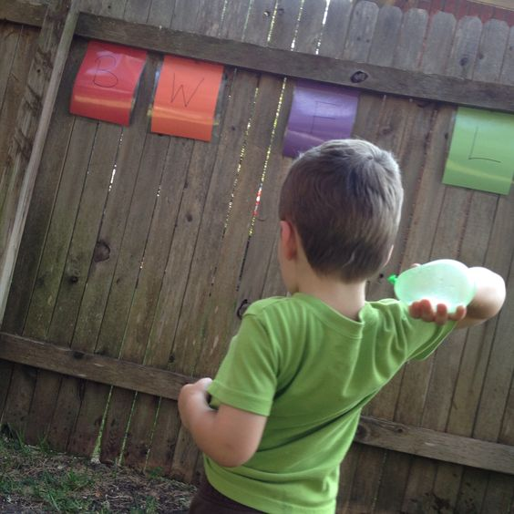 Water balloons and learning!  Write on laminated construction paper with permanent markers and tack them to an outside wall.  Have your child throw water balloons at the correct paper to answer questions you ask them.  Could use for letter or number recognition, site words, multiplication facts, etc, etc, etc! The sharpie comes off with nail polish remover so you can change the content!