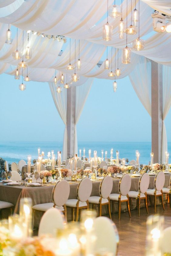 Magical Fairy Tale Beach Wedding Reception Decorations Lighting up your beach night can easily set the mood you are trying to create, no matter it's string lights, candles, light bulbs, lanterns or colored lights.