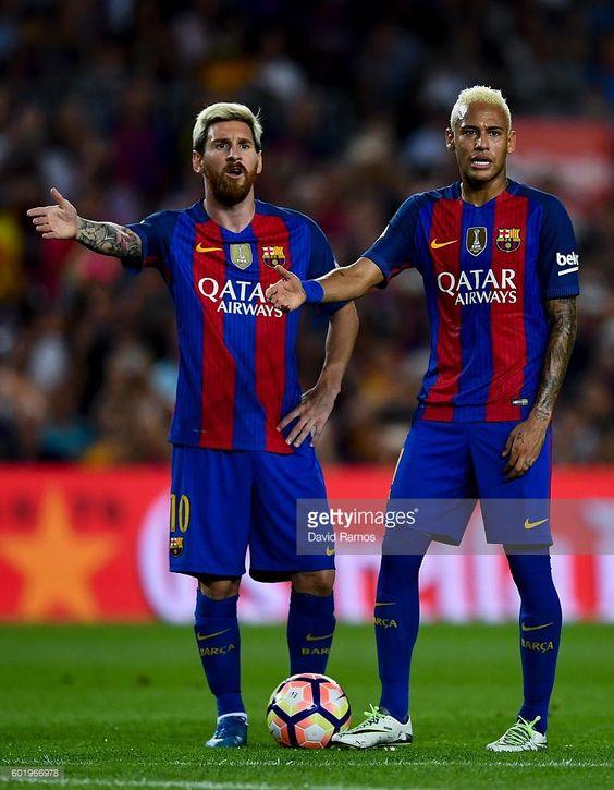Lionel Messi (L) and Neymar Jr. of FC Barcelona react during the La Liga match…