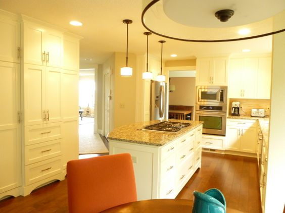 New creamy white shaker style cabinets and trim keep the kitchen light
