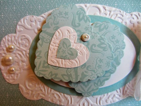 3 different sets of Framelits made this card: Hearts A Flutter, the Ovals Collection and Apothecary Accents.