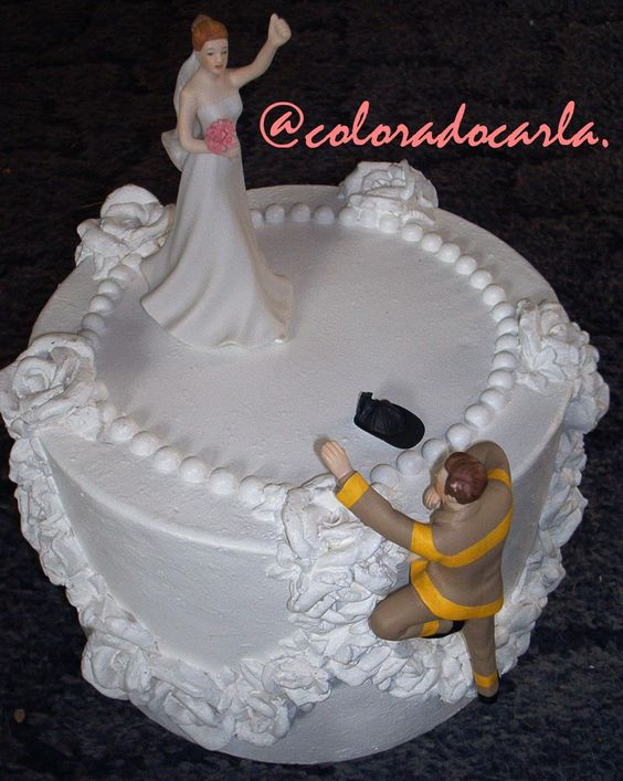 Firefighter groom rescuing bride cake topper