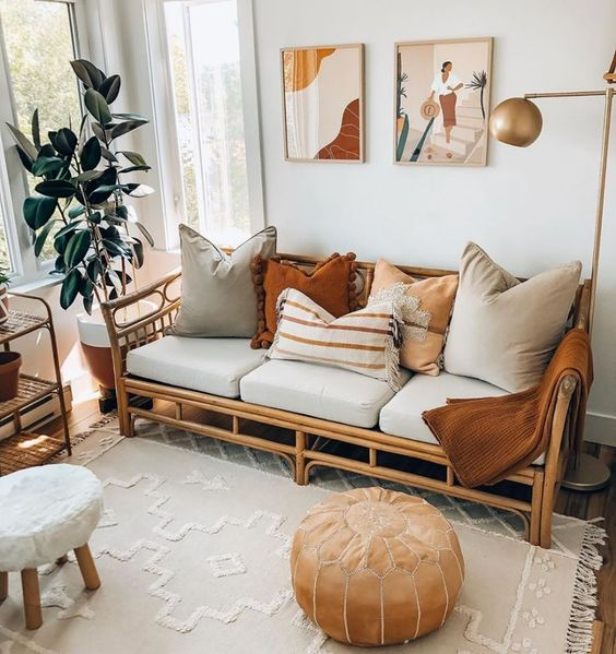 I'm loving this design idea for my next living room remodel! Love how the rattan sofa chair anchor this space while the warm decor & indoor plants adds a nice accent!