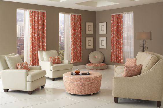 Bright apricot Ripplefold window treatments, ottoman and pillows enliven this contemporary living room. I Rowley Company