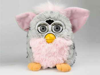 Furby! Another toy that people were trampling each other for. I had one exactly this color. That is, until it started making demonic clunking noises.