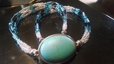 Apparitions Turquoise Cavishon Wrap