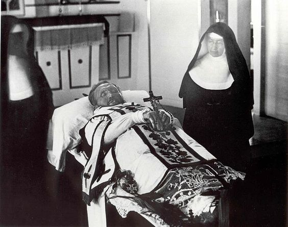 New Advent: This must be the first photograph of two saints together...St. Damien and St. Marianne Cope