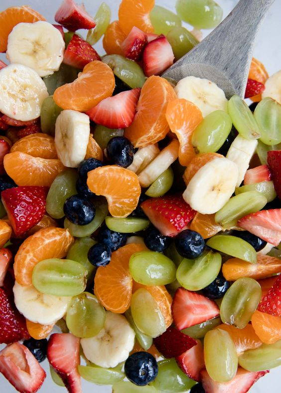 Rainbow Honey Lime Fruit Salad Recipe ...filled with fresh strawberries, oranges, bananas, grapes and blueberries. Topped with a honey lime glaze.