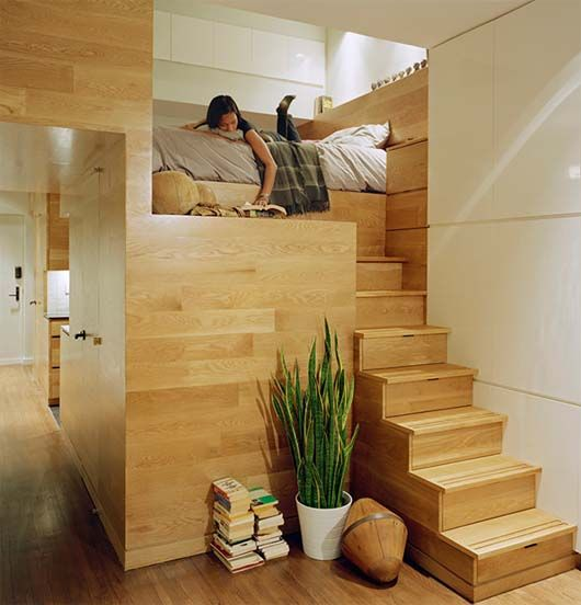 staircase with bed. looks so cozy!