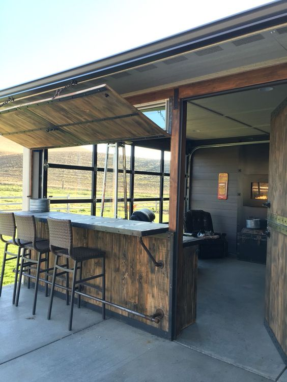 Fun Out door space with bar and sunroom. Glass garage door lets the outdoors in when cold months are on us and it can be opened in the warm months. Bar also closes and opens with hinged swinging doors.
